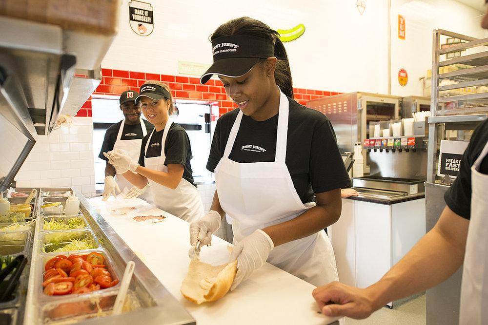Jimmy_John_employees_having_fun_making_sandwiches.jpg
