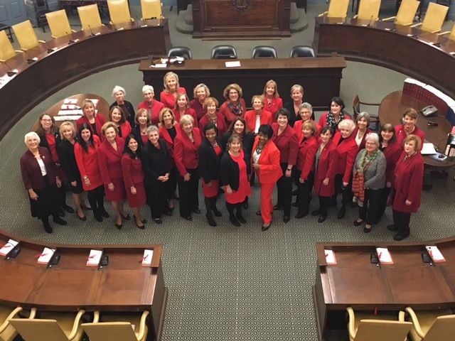 "The women of the MA legislature call attention to women with heart disease on ""Go Red for Women Day""."
