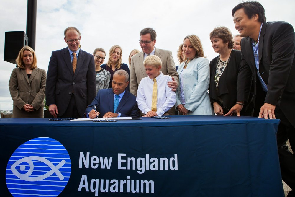 Governor Deval Patrick signs the bill banning the possession and sale of shark fins.
