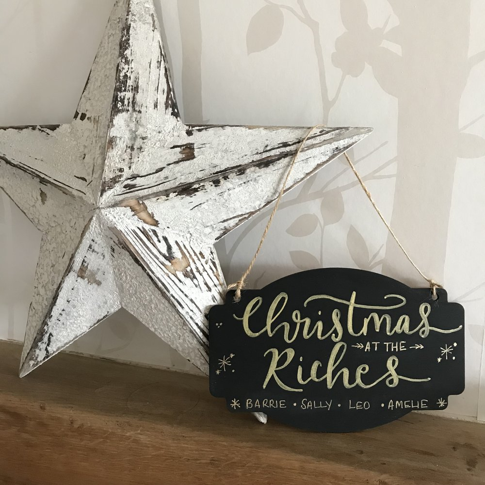 These beautiful hand lettered wooden plaques & stars come in either a stained oak finish or black chalkboard paint and can be personalised with your family name as well as individual names.  The oak stained stars come with white writing & the black chalkboard stars can be written in either gold, silver or white ink.  They are finished with twine for you to hang in your home.