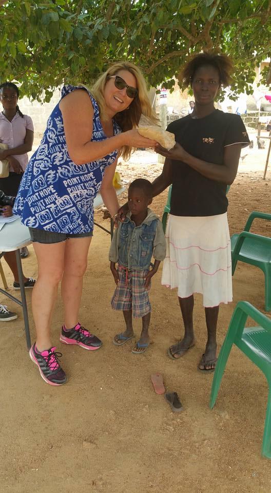 Mama Delilah distributes porridge