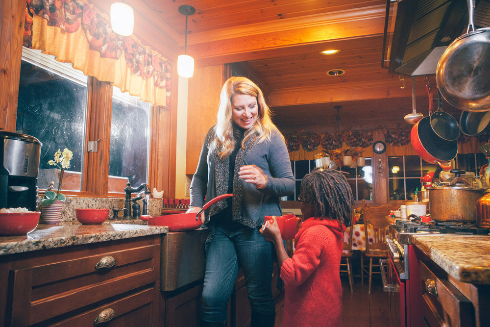 Delilah with her youngest daughter, Delilah, Jr., in their kitchen at home