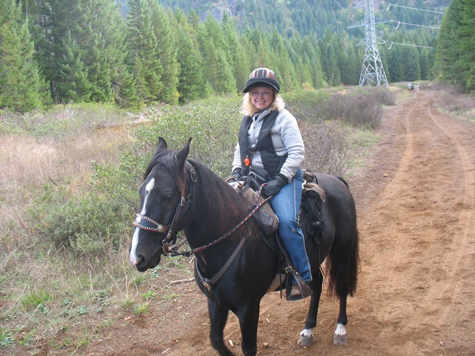 Debbie Sundberg at home on her horse