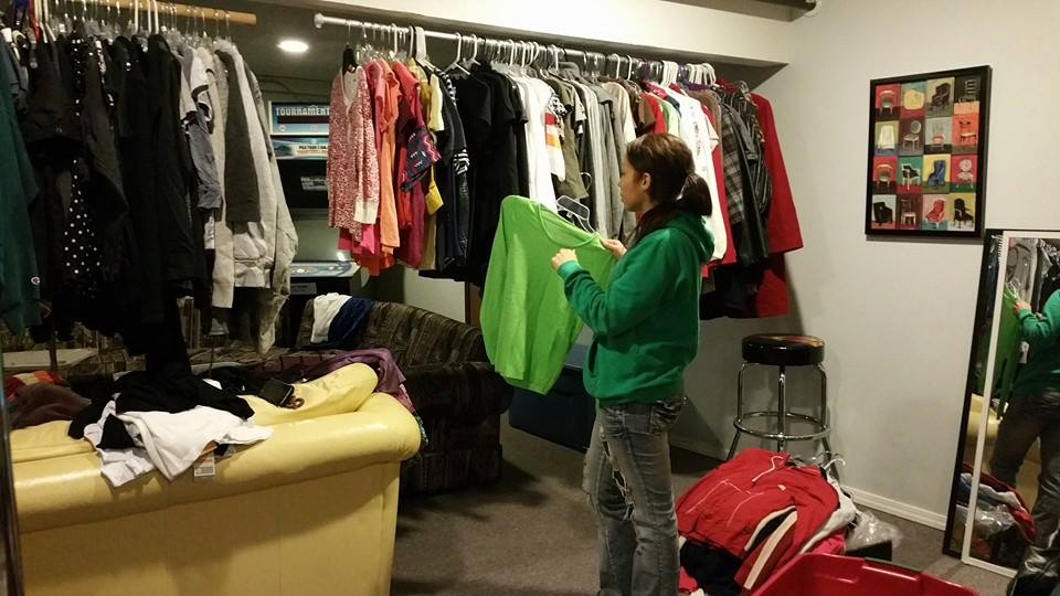 volunteer hanging clothes for the boutique.jpg