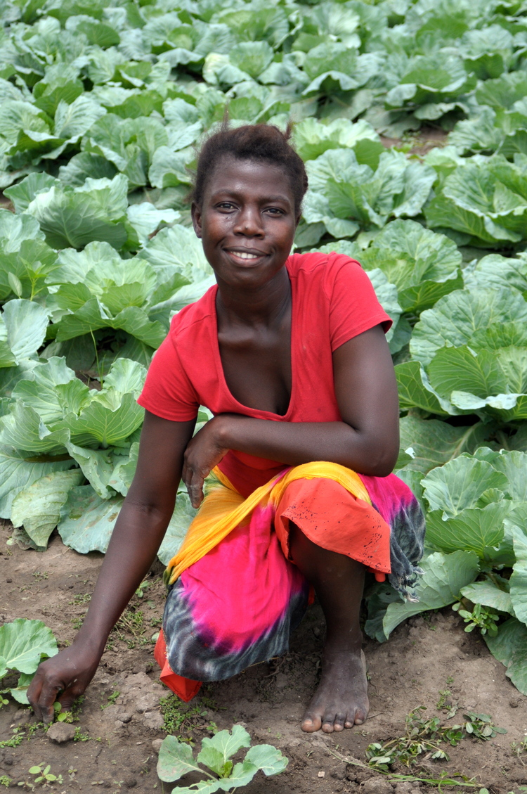 one of the farming students with cabbages.jpg
