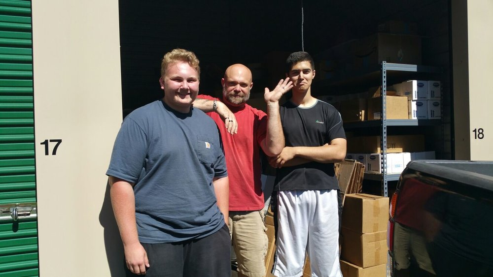 Volunteering isn't always glamorous (and doesn't mean you have to board an airplane).  Sometimes, as was the case with Michael, Tom, and Isaiah, volunteering can mean moving, stacking, hauling and getting things in place at the Point Hope storage facility so donations can bless others later.