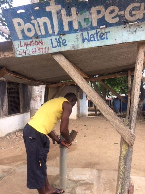 Marvin is unlocking the water faucet to begin selling water. The spigots must be locked between uses, as there is no other manner of securing the access to the water.