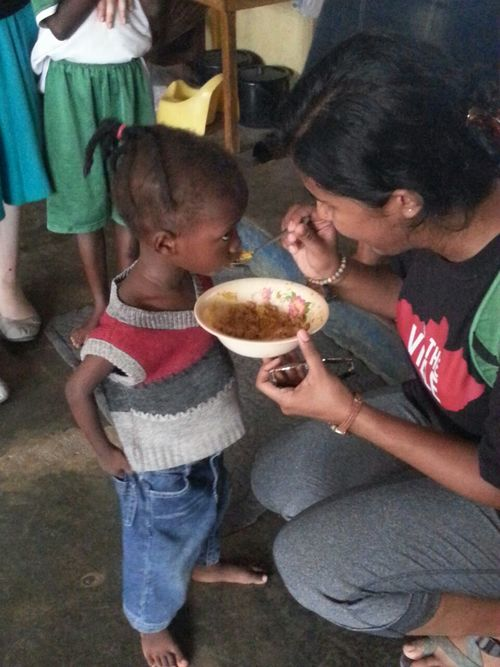Tasneem came from Kentucky to volunteer with Point Hope Ghana's exceptional Nutrition Program.  Sangay needed to eat, Tasneem was able to help her get some nutrition into her little body.