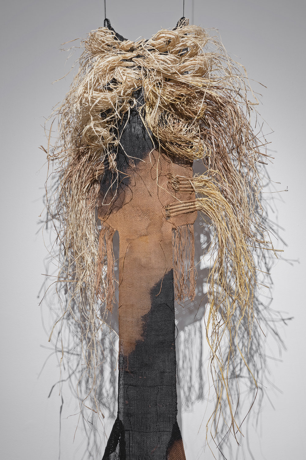 Mary Grisey, Numina of Akasha I – V , 2015, Handwoven & hand-dyed linen and raffia, bleach, rust, XIT-RM Gallery, Art Gallery of Mississauga. Photo by Toni Hafkenscheid.