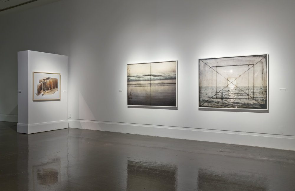 The View From Here , Main Gallery, Art Gallery of Mississauga. Left: Jason Gowans, Landscape 3 , 2013. Right: Susan Dobson, Seneca 5 x 7 View Camera, circa 1940 , 2013. Sanderson Tropical Field Camera Half Plate, circa 1920 , 2014. Photo by Toni Hafkenscheid.