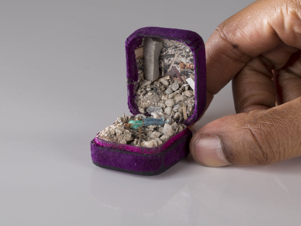TALWST, Tell them to stop! Tell them to stop! , Reclaimed 1970's ring box, model putty, plastic, crushed concrete, dirt, wood, aluminium wire, paper, acrylic paint, 2014, XIT-RM Gallery, Art Gallery of Mississauga. Photo by Todd Duym.