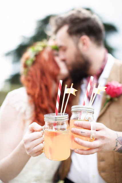 Rustic-Bride-and-Groom-with-their-cocktails.jpg