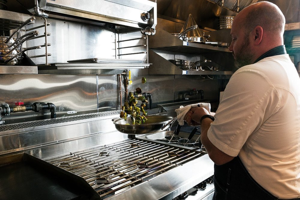 Chef Dan Kluger cooking at Loring Place