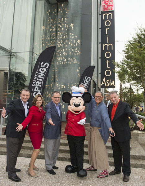 From left to right: Disney Springs Vice President Keith Bradford, ESPN Senior Vice President Maribeth Bisienere, Walt Disney World Resorts George Kalogridis, Mickey Mouse, Chef Masaharu Morimoto and Patina Restaurant Group CEO Nick Valenti at the opening of Morimoto Asia at Disney Springs