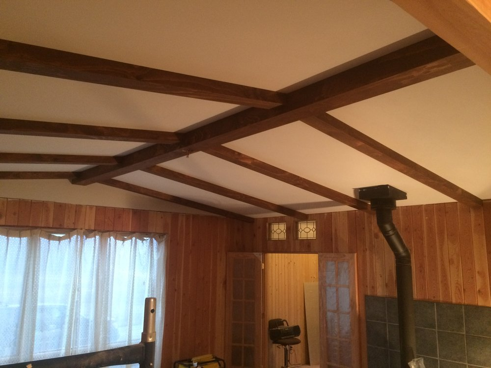 Ceiling beams by Green Goose Renovations