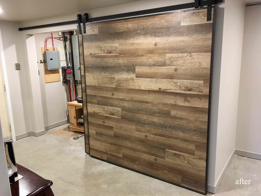 Custom hand made barn doors to hide storage area.