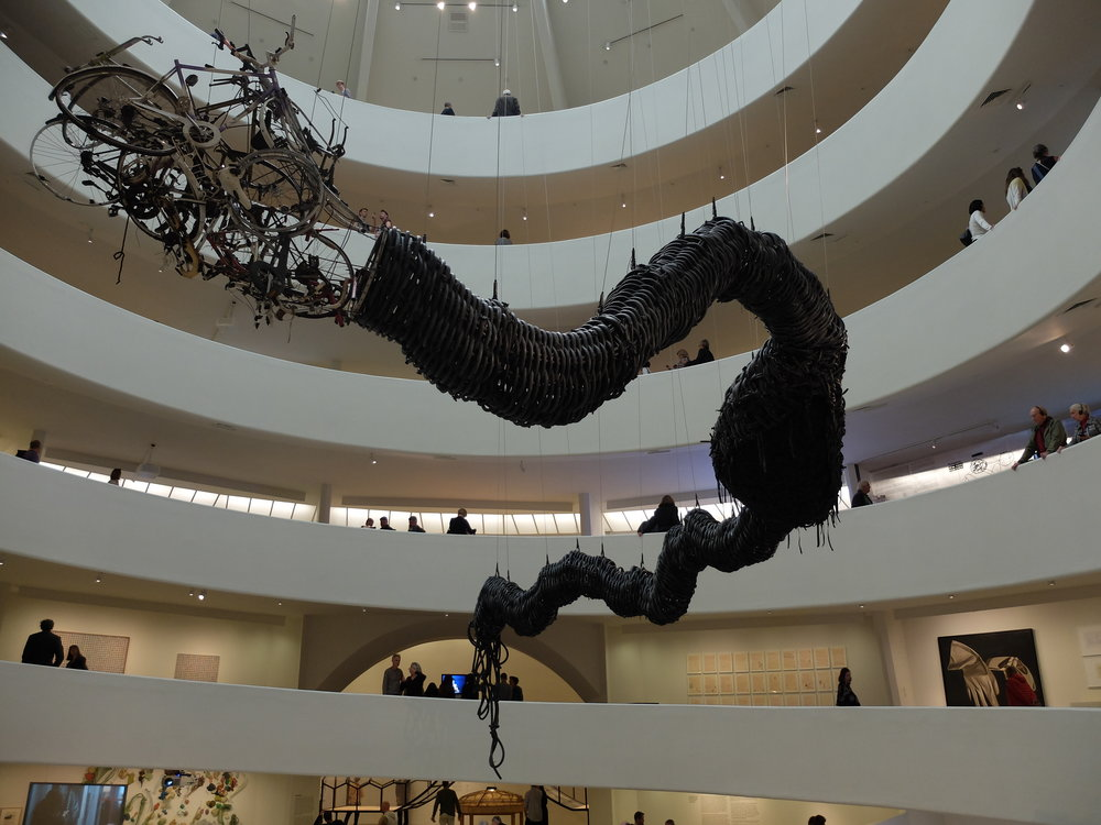 Precipitous Parturition - Guggenheim - ART & CHINA AFTER 1989 THEATER OF THE WORLD - 1999 - Chen Zhen Made from Bicycle inner tubes, toy cars, metal & fragments of bicycles…