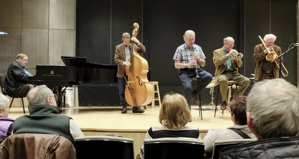The coronet player (middle) is Lee Lorenz.  He supports his jazz habit as a New Yorker cartoonist and its former Art Editor.