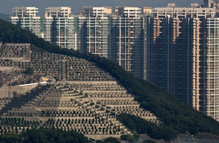A hillside necropolis mirrors the cramped quarters of the living in Hong Kong