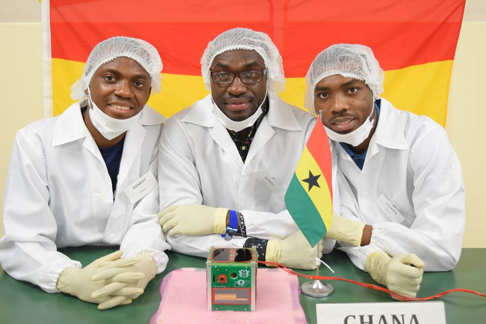 Ghanaian scientists from All Nations University pose with the GhanaSat-1 cubesat