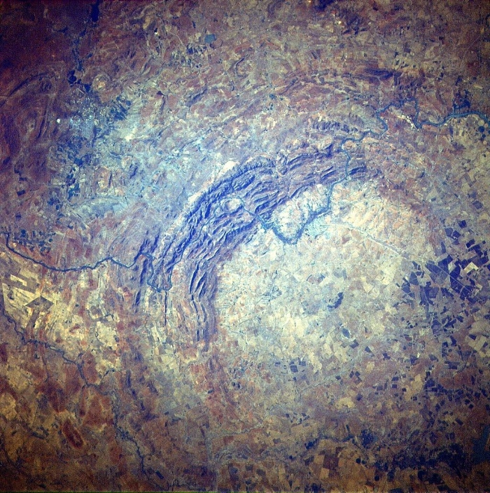 300 km in diameter, the Vredefort Dome in South Africa is world's largest impact site.