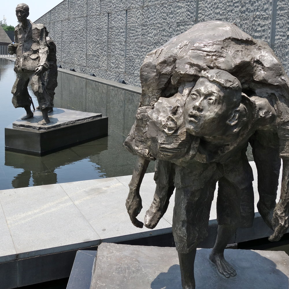 Statue depicting a 13 year old boy carrying his dead grandmother on display at the Nanjing Massacre Memorial Hall in Nanjing, China.