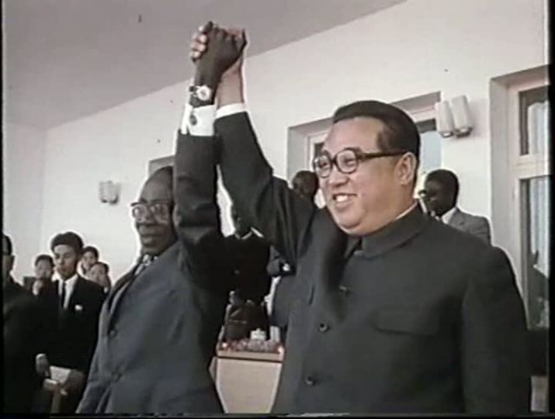 Kim Il Sung holds hands with Zimbabwe's Robert Mugabe