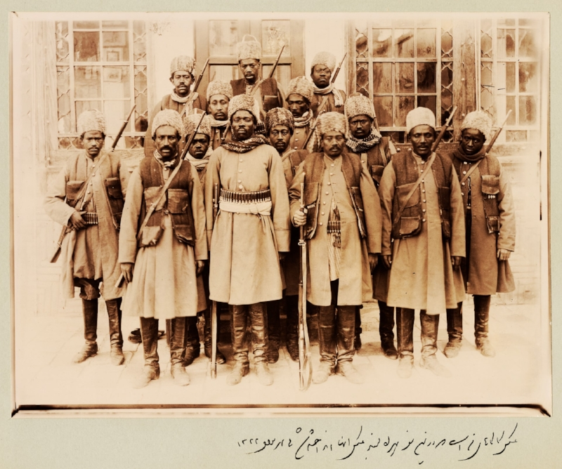Slaves who were not eunuchs were sometimes assigned to the armies of the Qajar elites. The 14 pictured here belonged to Qajar prince Zell-e-Soltan, Ghameshlou, Isfahan, 1904. Photograph: Zell-e-Soltan/Kimia Foundation | Caption and photograph attributed to Dr. Pedram Khosronejad in  The Guardian