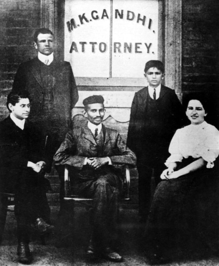 Gandhi (centre) with his secretary, Miss Sonia Schlesin, and his colleague Mr. Polak in front of his Law Office, Johannesburg, South Africa, 1905.