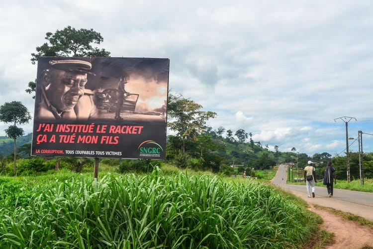 """""""I instituted the racket that killed my son"""" - an anti-corruption awareness billboard in Ivory Coast 