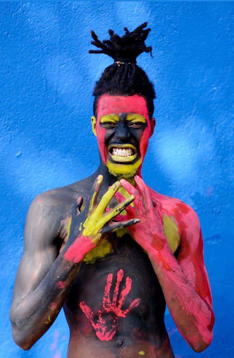 A painted man grimaces for the camera of Ugandan photographer Dazzle Jam |  PEXELS - DAZZLE JAM