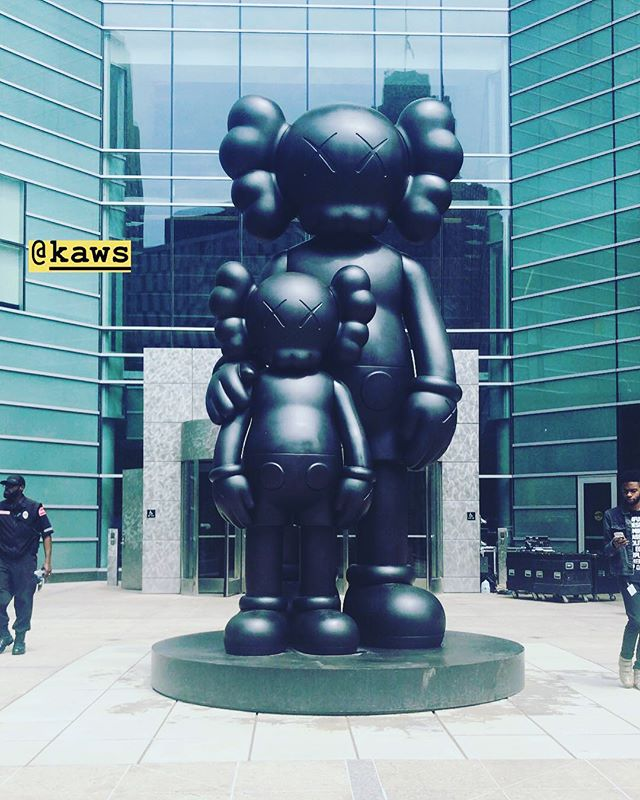 Not everyone gets to pass by a sculpture from one of the world's most widely-recognized, influential artists on their way to work - but we're so excited we do! This installation by KAWS, called WAITING, is now officially a part of downtown Detroit! #KAWS #DetroitArtCollection #DetroitArt #CampusMartius #detroitartcollection