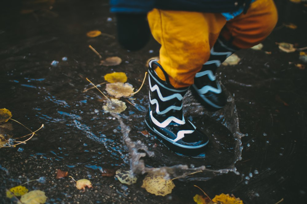 Child jumping in puddle.jpg