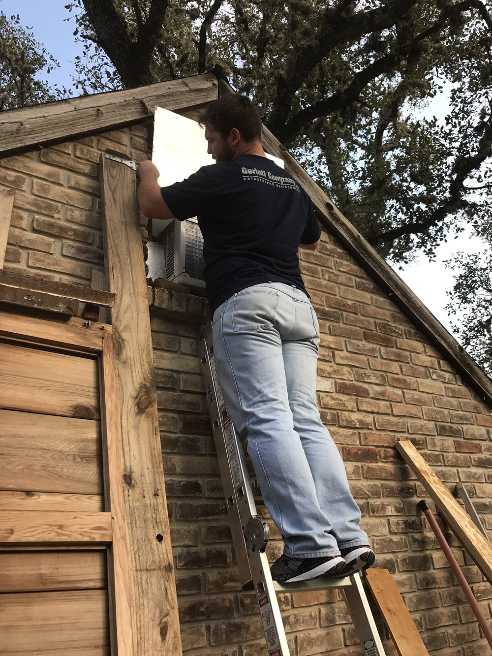 Logan installing one of our window units through an old side vent!