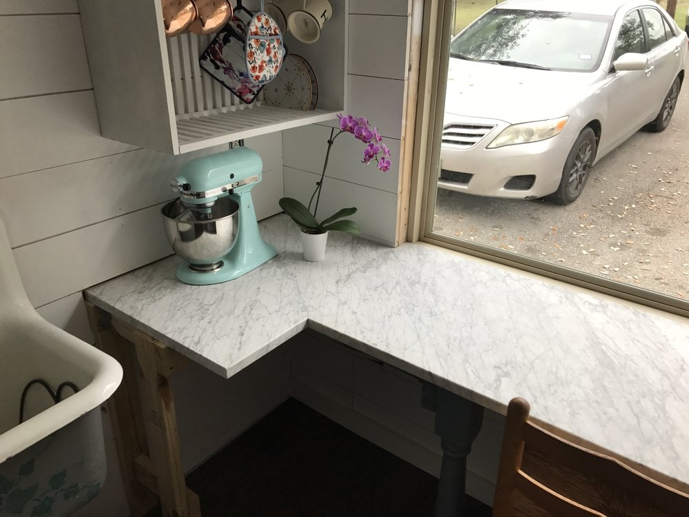 Our counter partially installed. We have the best friends who came over to help and gift us with this beautiful marble!