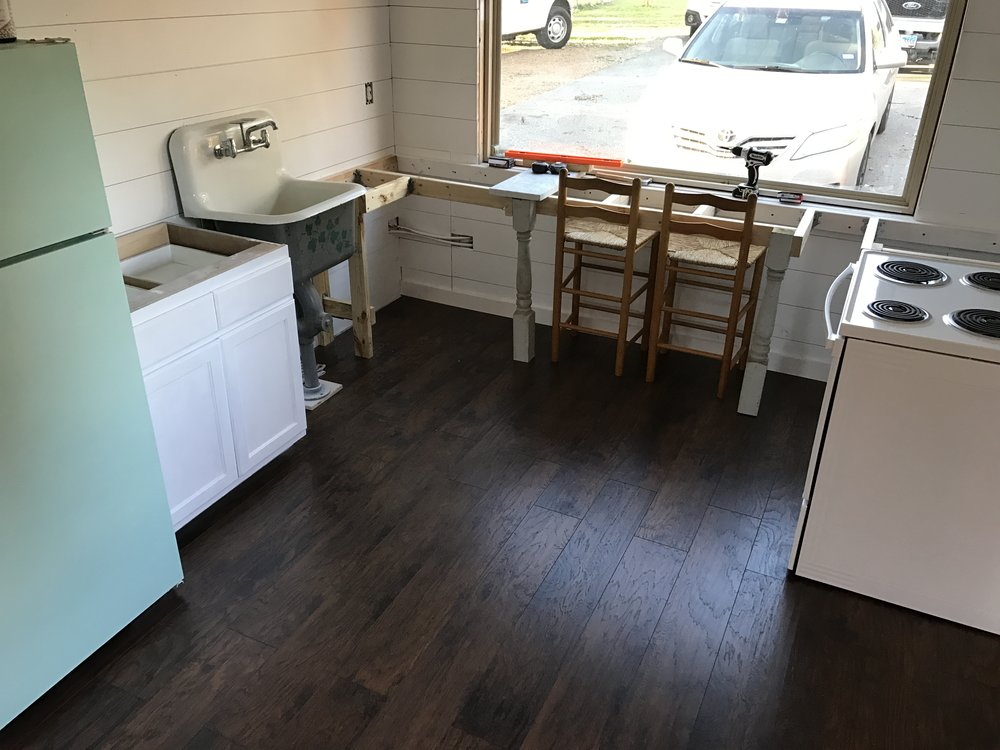 Overview of our kitchen. Old fridge that I spray painted, and we have a oven & stove! Holla!!