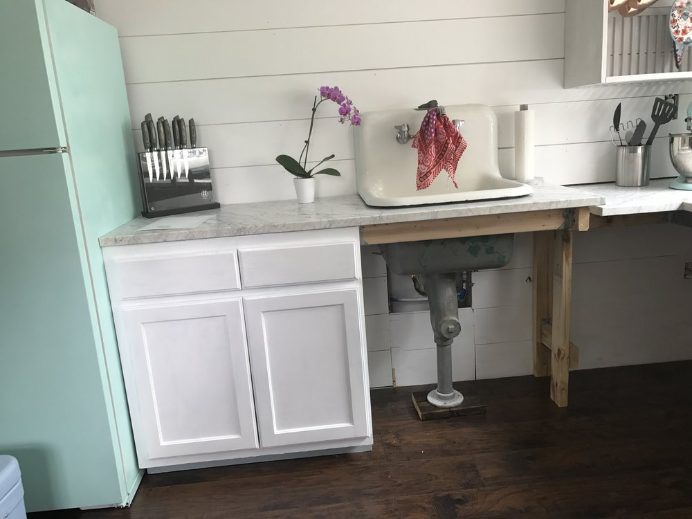 We used this old sink from my parents laundry room. I love how it fits perfectly in our little home!