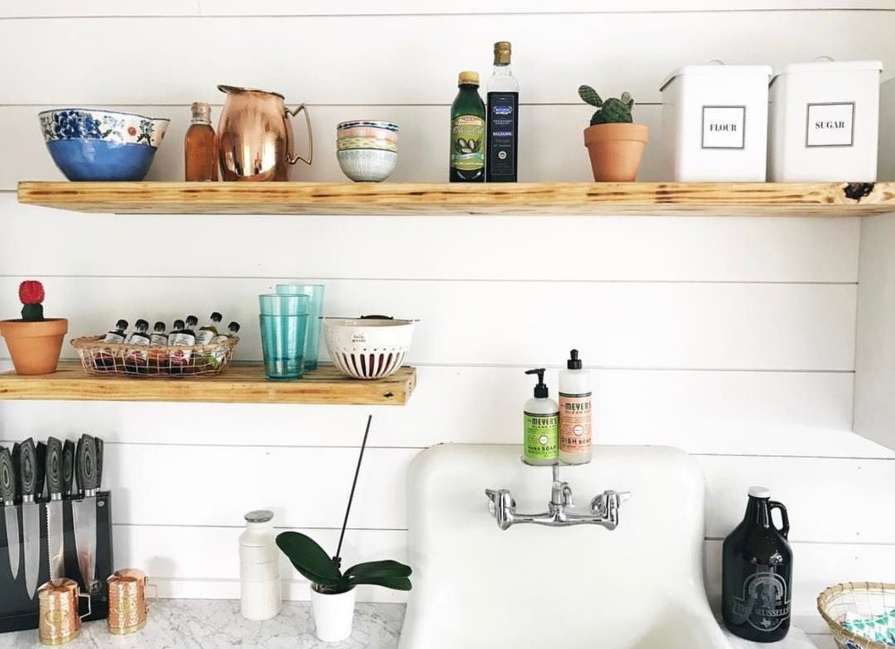 Our floating shelves are by far my favorite part of the kitchen. Logan lost a toe nail working on these, ouch... worth it? I think so :)