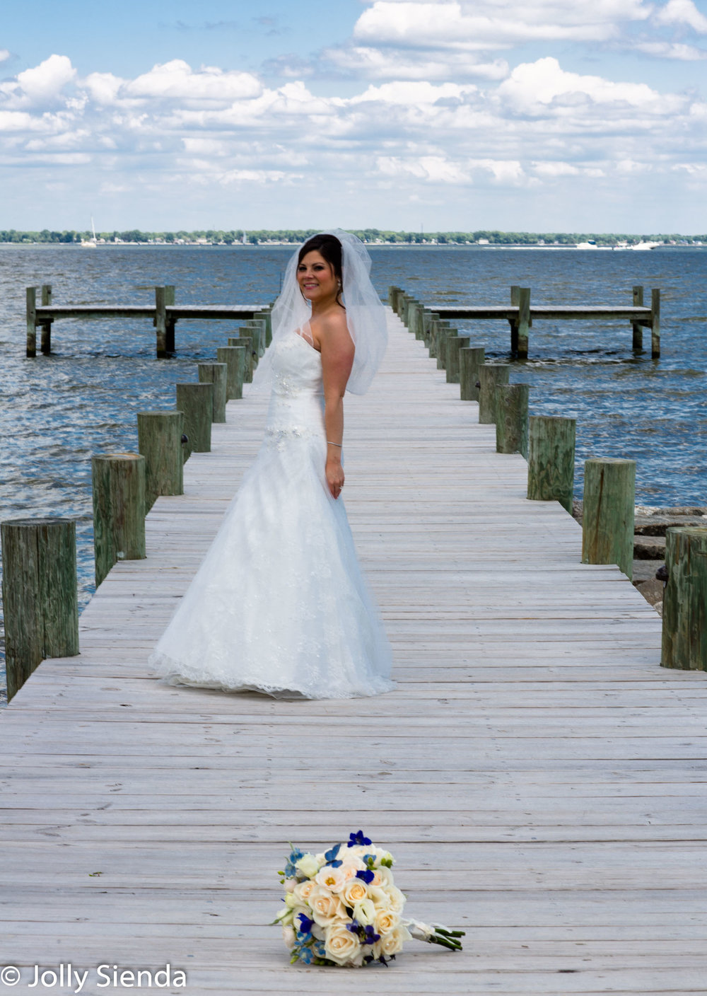 Wedding photography, the bride, the beach, and the bouquet