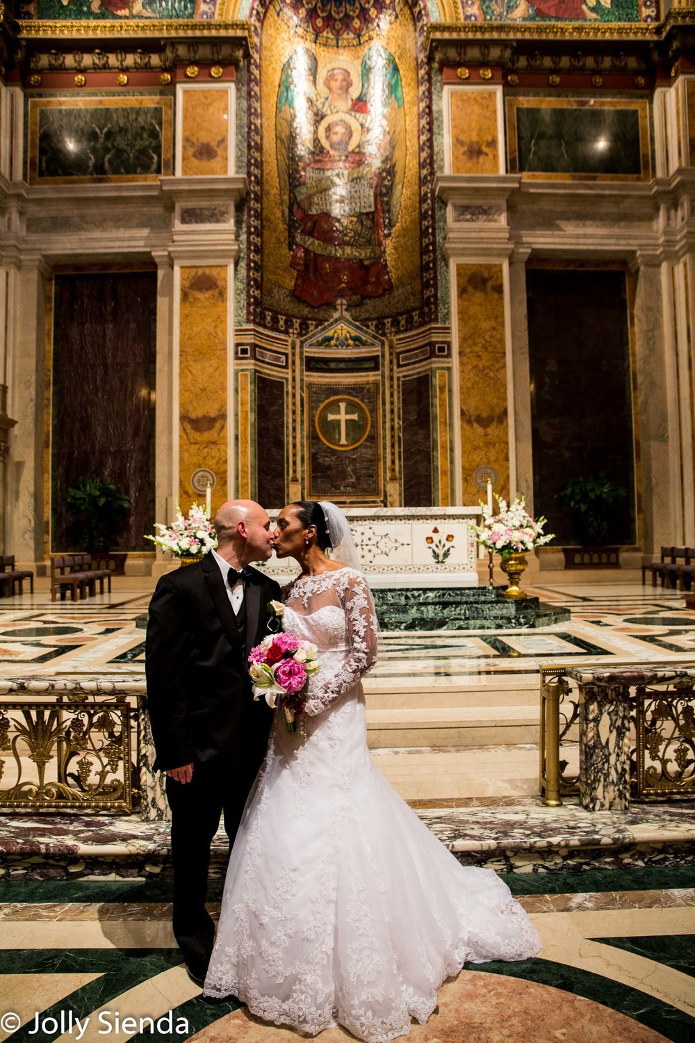 Portrait of a Bride and groom kiss at the wedding alter