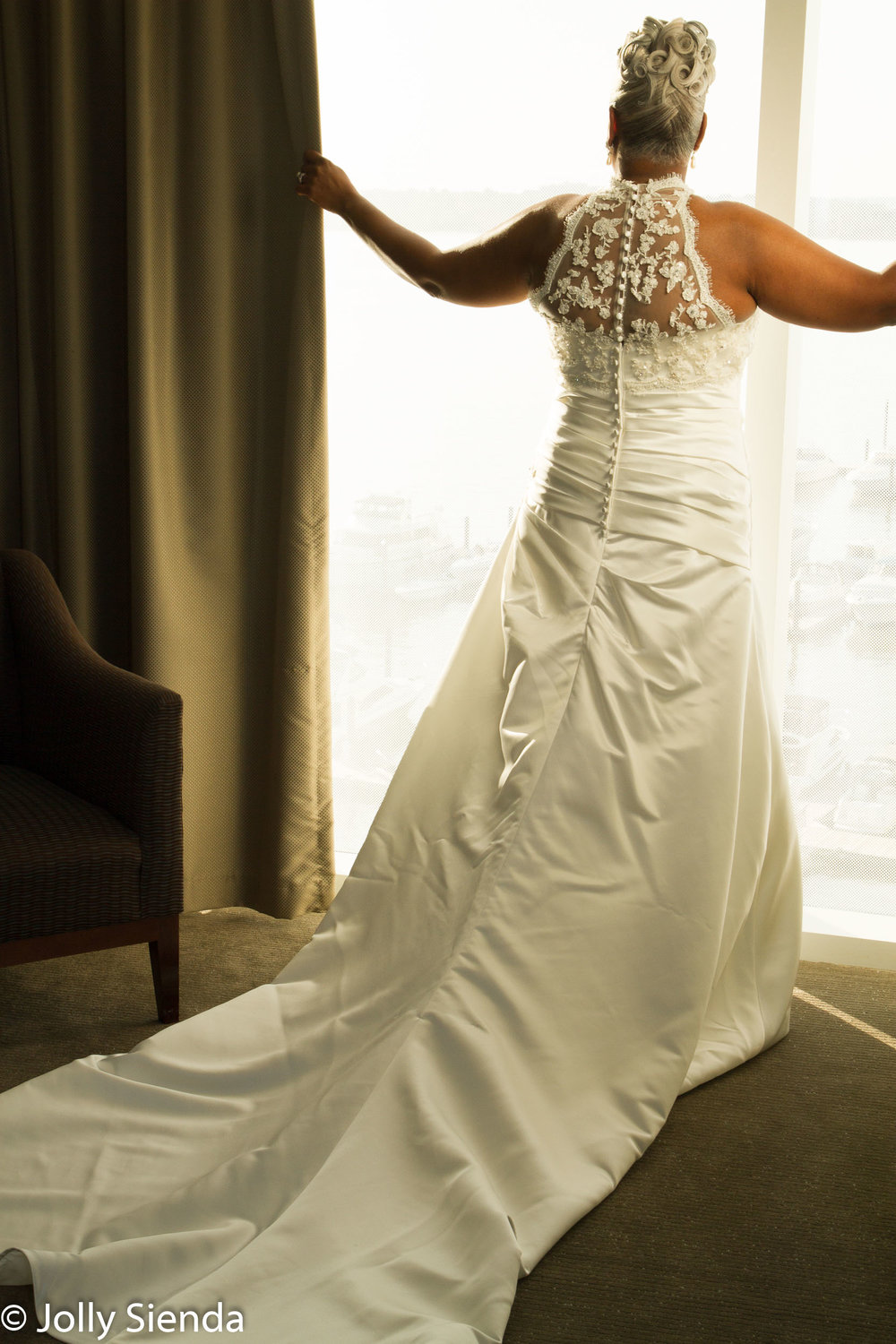 Mature bride and the lovely back of her wedding dress