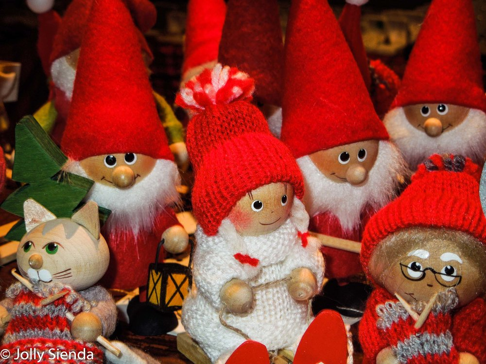 Swedish Norwegian wooden dolls with red hats, and a wooden cat