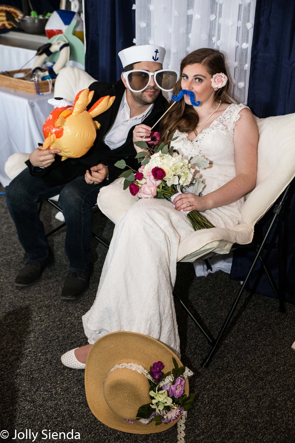Oversized sunglasses and costume fun for the bride and groom at