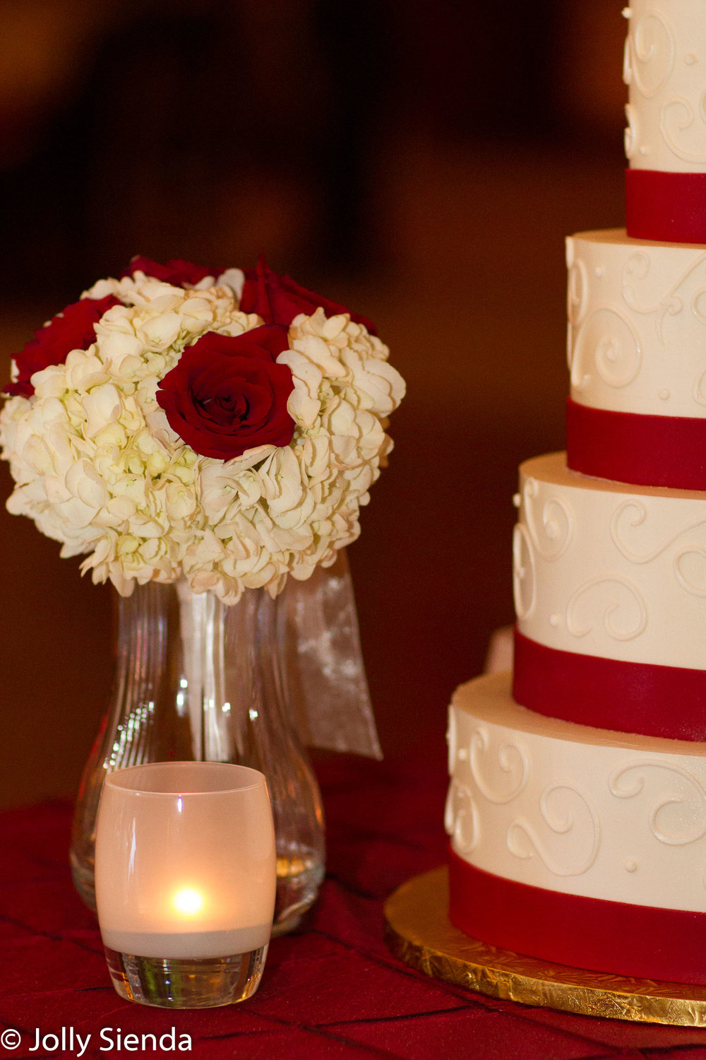 Red Roses and red and white wedding cake