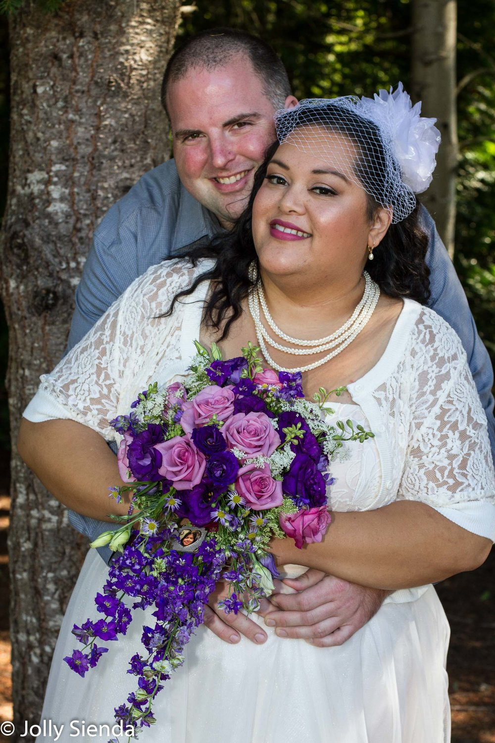 Bride and groom wedding portrait, in the forest, with bouquet