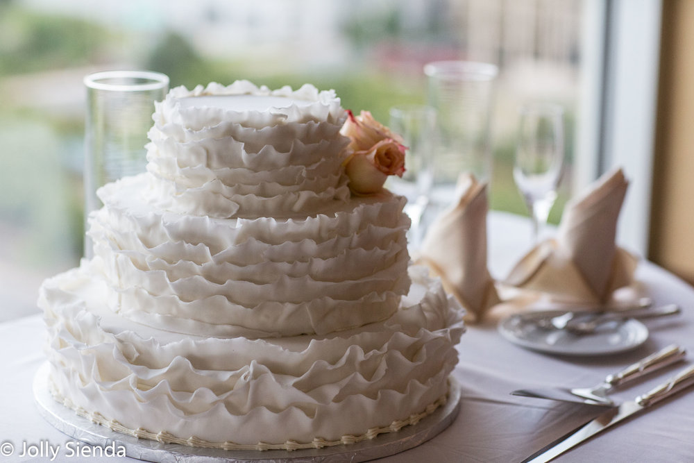 Three Tier White Chiffon Wedding Cake with Pale Peach Roses
