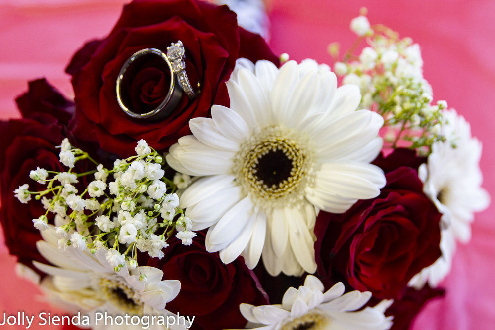 Wedding rings on the bridal bouquet is gorgeous and so romantic! This is one of my signature photos that I love to create for all of my couples.