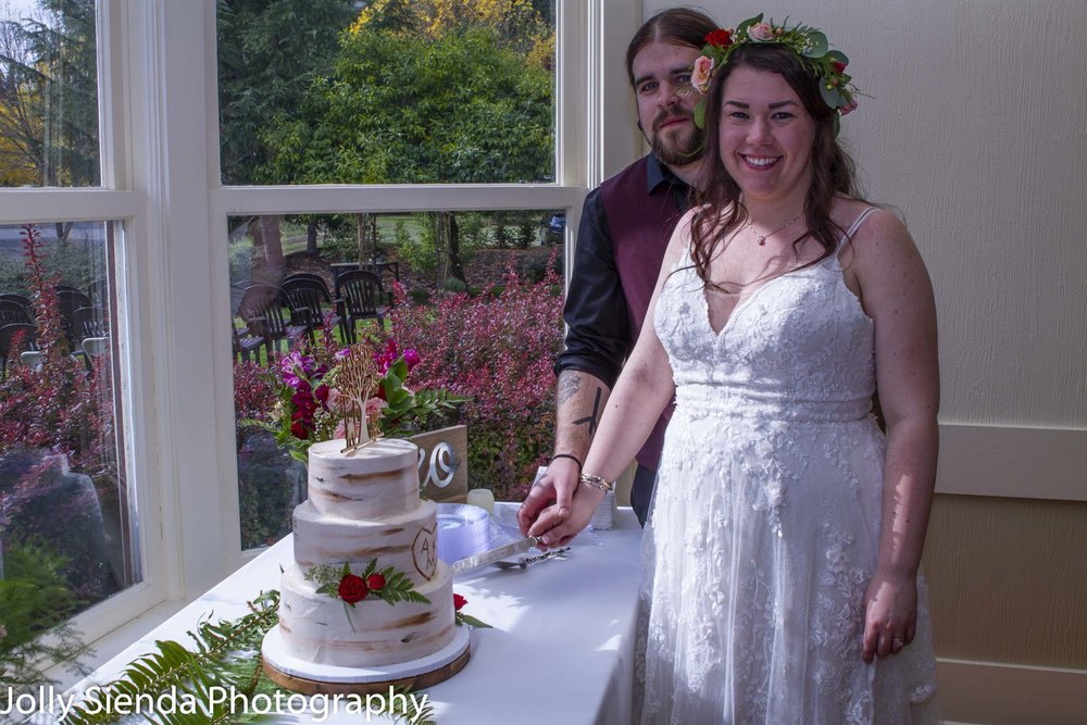Amanda Marie and Matt Godsey cut their wedding cake