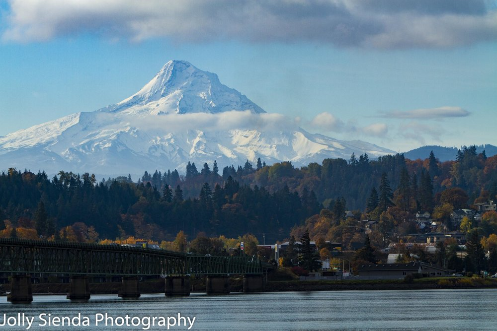 Snow capped Mount Hood looms over Hood River, Columbia River Gorge, and the Hood River Bridge