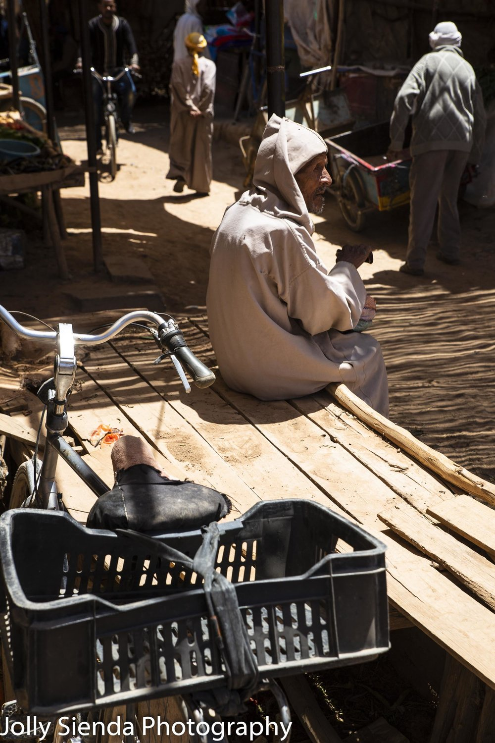 Moroccan people in a souk and bikes